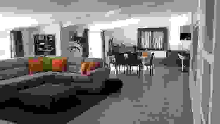 Living moderno con divano angolare e pouf e zona pranzo di Meka Arredamenti Moderno Tessuti Ambra/Oro