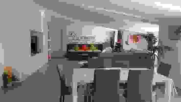 Zona pranzo con area living e panca contenitore di Meka Arredamenti Moderno