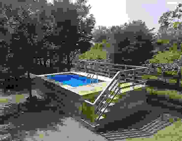 Piscina fuori terra rivestita in legno, montaggio fai da te, modello Clik Clak® homify Giardino con piscina