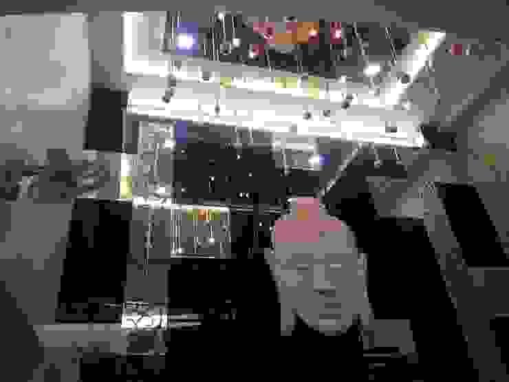INTERIOR DESIGNERS 7WD Design Studio Modern living room Glass Black