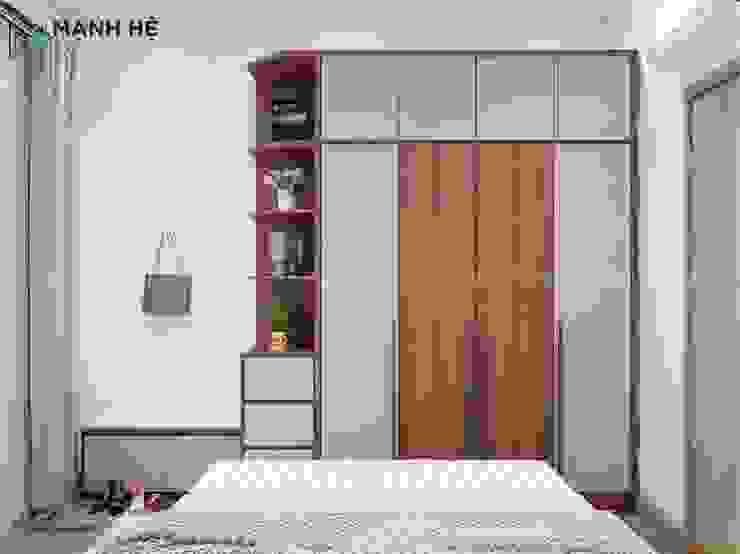 Hệ tủ gỗ công nghiệp thông minh cho phòng ngủ master đẳng cấp Phòng ngủ phong cách hiện đại bởi Công ty TNHH Nội Thất Mạnh Hệ Hiện đại