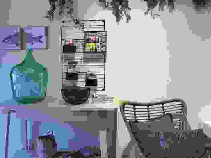 Elementos decorativos con esencia mediterránea Hoteles de estilo mediterráneo de A interiorismo by Maria Andes Mediterráneo Madera Acabado en madera