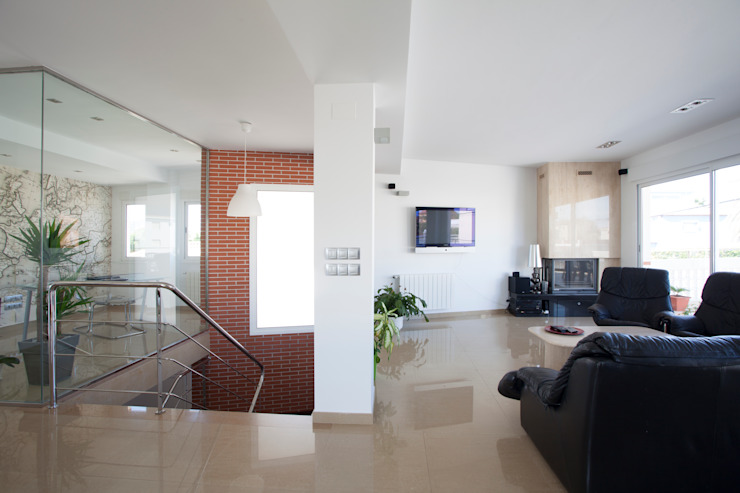 Rehabilitación integral de vivienda unifamiliar. de Barreres del Mundo Architects. Arquitectos e interioristas en Valencia. Moderno