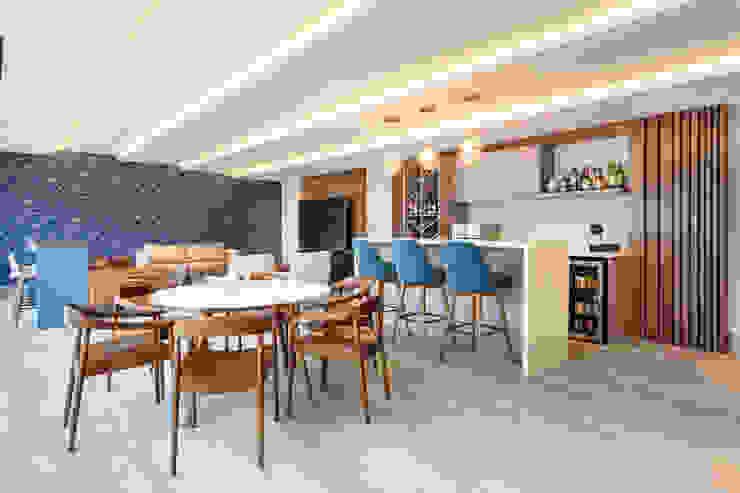 Modern dining room by ESTUDIO TANGUMA Modern