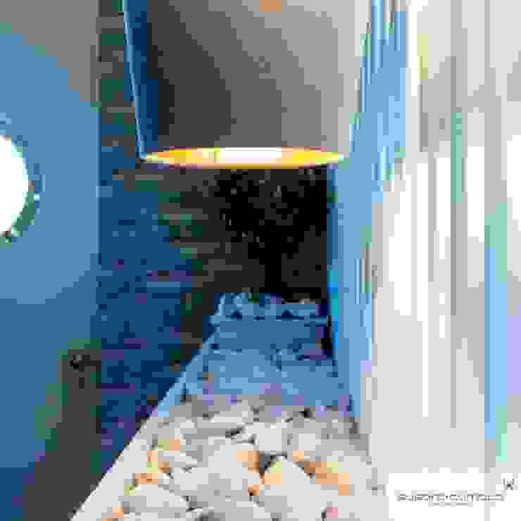 Susana Camelo Paredes y pisos de estilo rústico Aglomerado Azul