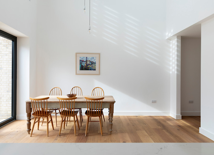 Double height dining space Modern dining room by TAS Architects Modern