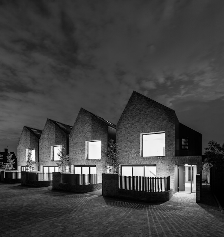 Four houses at night by TAS Architects Modern