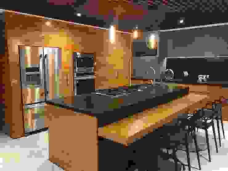 WM ACABADOS + INTERIORISMO Built-in kitchens Granite Wood effect