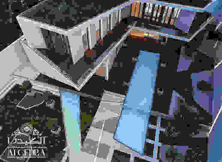 تصميم فيلا فاخرة على الطراز الحديث مع حمام سباحة صغير ومناظر طبيعية من Algedra Interior Design حداثي