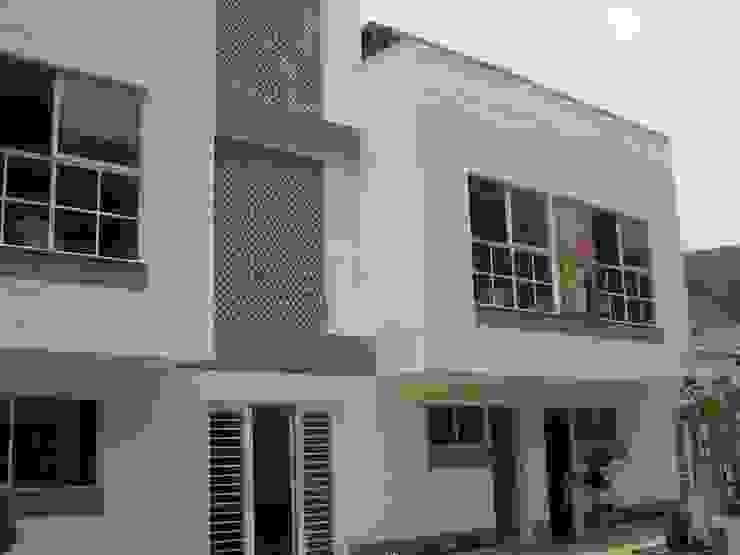 DISEÑO Y CONSTRUCCIÓN INSTITUCIÓN EDUCATIVA Estudios y despachos de estilo minimalista de Martha L. Ladino Construcciones SAS Minimalista Concreto