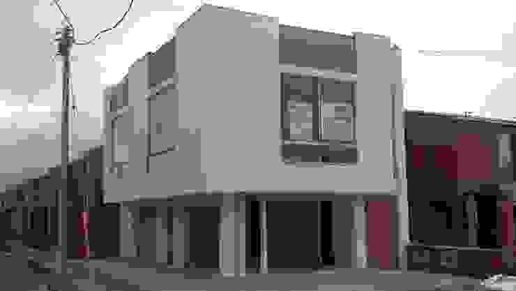 DISEÑO Y CONSTRUCCIÓN LOCALES COMERCIALES Bodegas de estilo minimalista de Martha L. Ladino Construcciones SAS Minimalista Aluminio/Cinc
