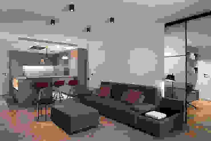 Vista al salón y cocina Salones de estilo moderno de MANUEL GARCÍA ASOCIADOS Moderno