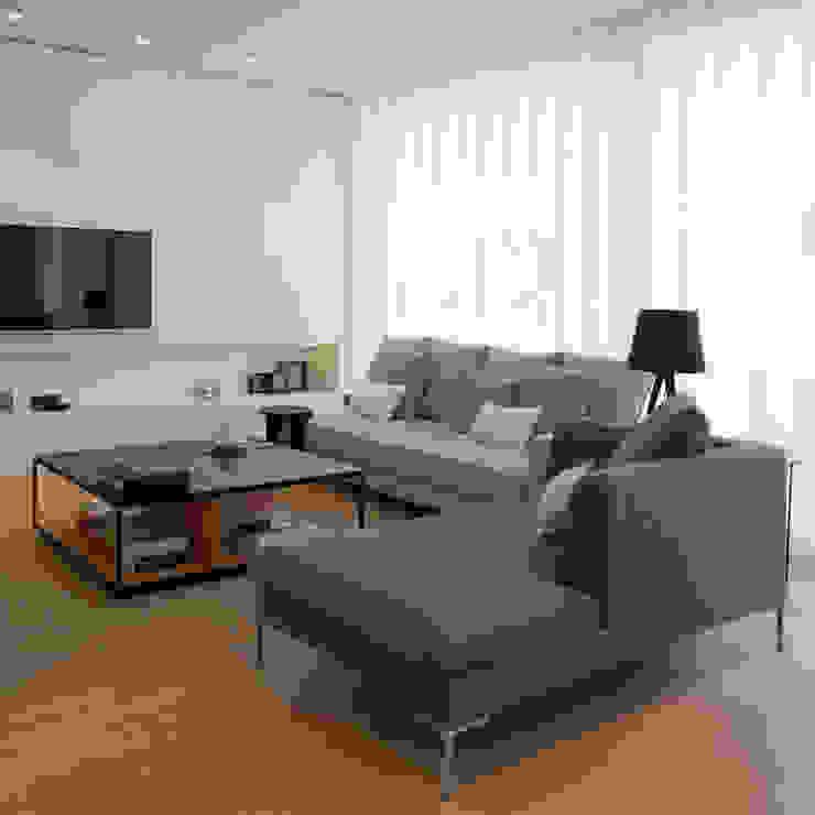 Zona de estar. Salón MANUEL GARCÍA ASOCIADOS Salones de estilo moderno Blanco