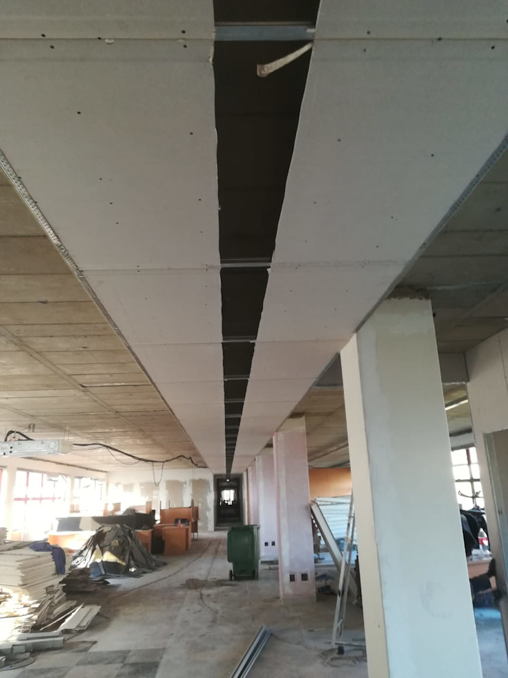 Fixing the ceiling by Mike's Building Projects & Maintenance Pty Ltd