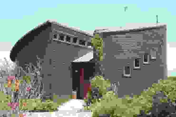 Casa Chauriye, Yunquen, Chile de MONAGHAN DESIGN SAS Moderno Derivados de madera Transparente
