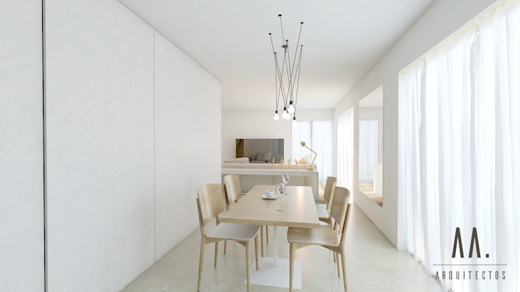 Sala de jantar e de estar por AA.Arquitectos