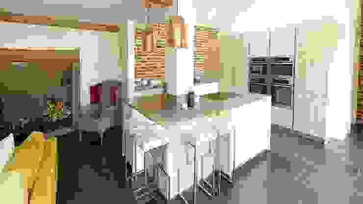 Breakfast bar in barn conversation - Brick wall feature Modern Kitchen by PTC Kitchens Modern