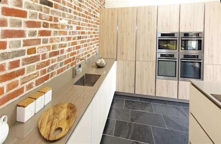 Brick wall feature Modern Kitchen by PTC Kitchens Modern