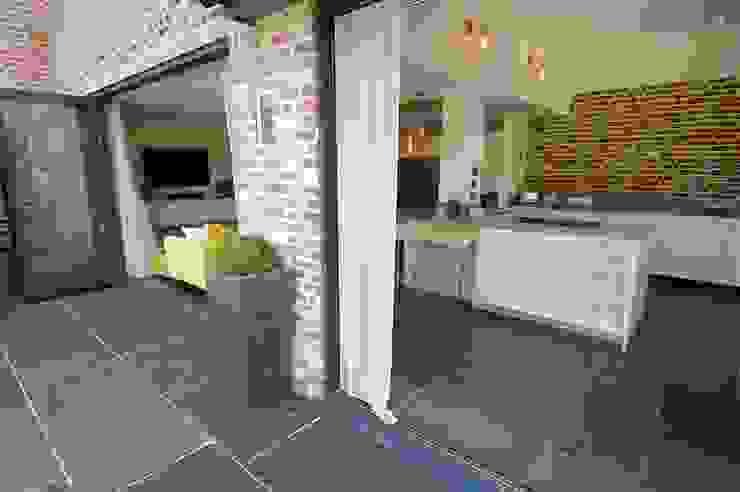 Open kitchen and living room with bi-fold doors PTC Kitchens ห้องครัว Wood effect
