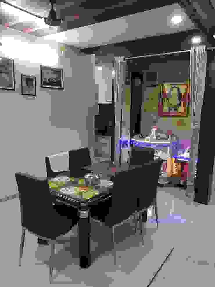 Ragiben 'A' DESIGN ASSOCIATES Modern dining room