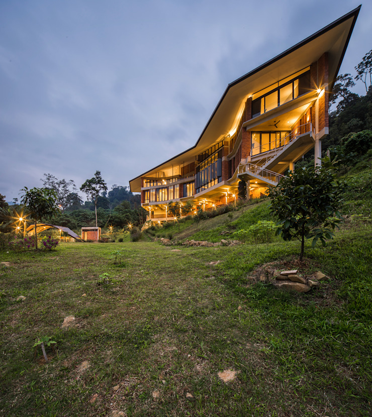 Evening view Tropical style houses by MJ Kanny Architect Tropical