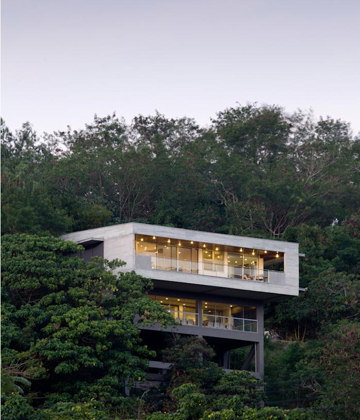 MV House - Two Storey Modern House on a Cliff in Ayala Greenfieds, Calamba Laguna Philippines by 8X8 Design Studio Co. Minimalist Concrete