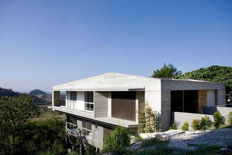 MV House - Two Storey Modern House on a Cliff in Ayala Greenfieds, Calamba Laguna Philippines by 8X8 Design Studio Co. Minimalist