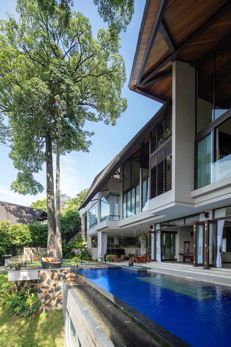 Piscinas de estilo tropical de MJ Kanny Architect Tropical