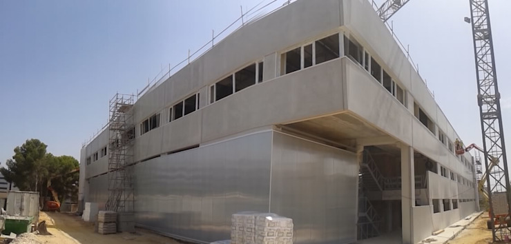 Ejecutando las fachadas Casas de estilo industrial de OCTANS AECO Industrial