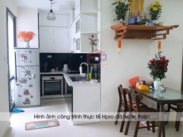 Hình ảnh thực tế mẫu tủ bếp gỗ công nghiệp chữ L acrylic đẹp nhà anh Nam – Đại Mỗ Nội thất Hpro KitchenCabinets & shelves Gỗ Multicolored