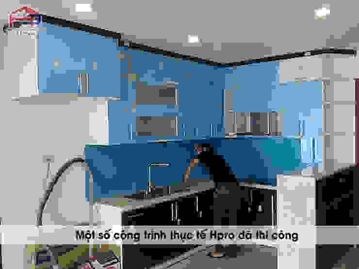 Ảnh thực tế nhà bếp đẹp hiện đại bằng chất liệu gỗ acrylic bóng gương An Cường Nội thất Hpro KitchenCabinets & shelves Gỗ Multicolored