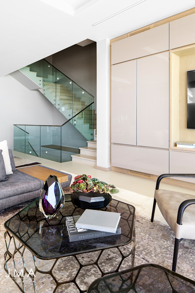 Connected Atlantic Living - Living area and staircase Modern living room by Jenny Mills Architects Modern