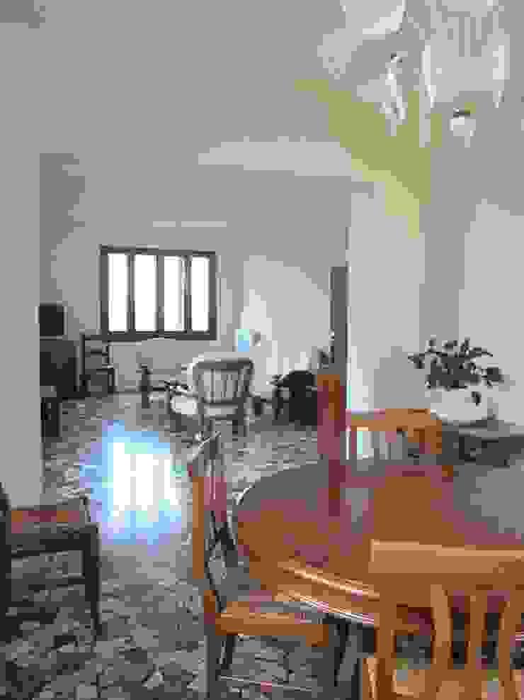 Salotto open space Studio Dalla Vecchia Architetti Soggiorno classico
