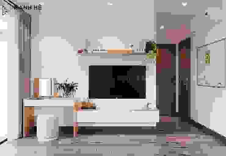 Kệ tivi treo tường nối liền bàn trang điểm phòng ngủ master bởi Công ty TNHH Nội Thất Mạnh Hệ Hiện đại
