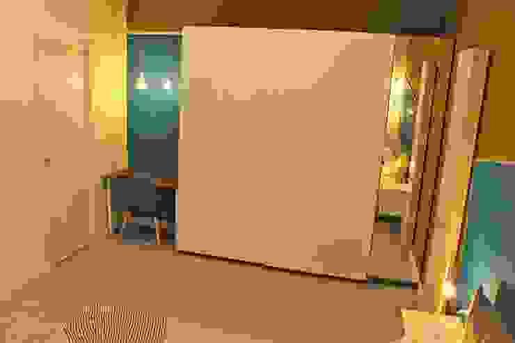 Stanza da letto 2 _dopo Camera da letto moderna di antonio felicetti architettura & interior design Moderno Legno Effetto legno