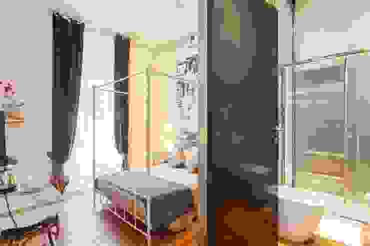 Camera da letto 1 Camera da letto in stile rustico di ibedi laboratorio di architettura Rustico