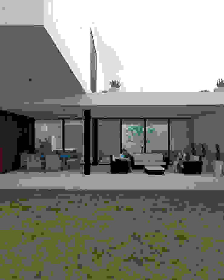 vista desde jardin GH Arquitectos Balcones y terrazas minimalistas