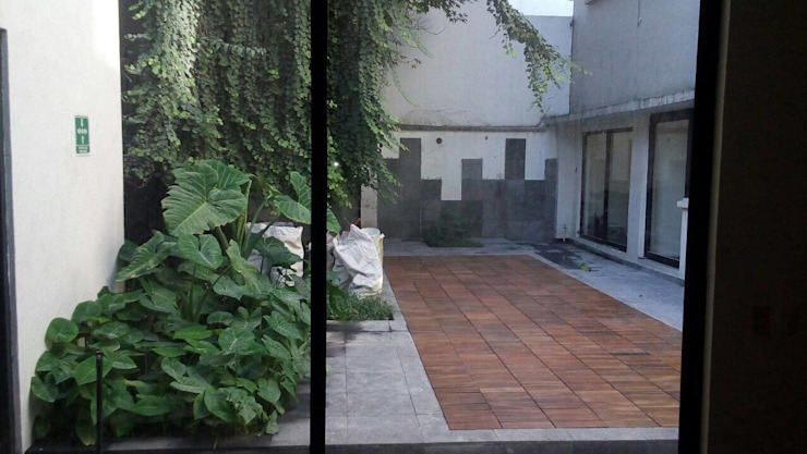 Show Room Jardines rústicos de ARQUITECTURA E INGENIERIA GOZPIN S.A. DE C.V. Rústico