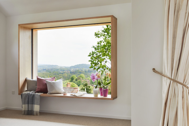 Eco House Crowley: a Large Bay Window Baufritz (UK) Ltd. BedroomAccessories & decoration