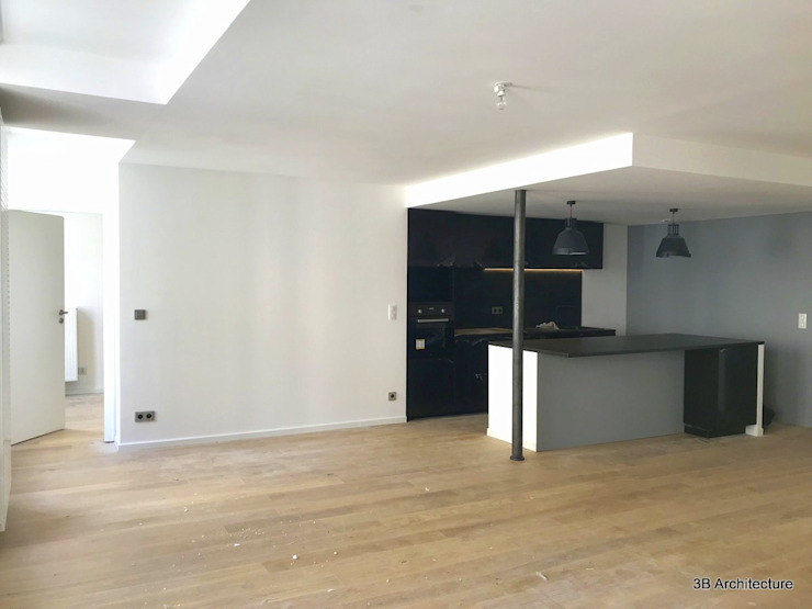 Vue de la cuisine ouverte sur l'espace de vie Salle à manger moderne par 3B Architecture Moderne