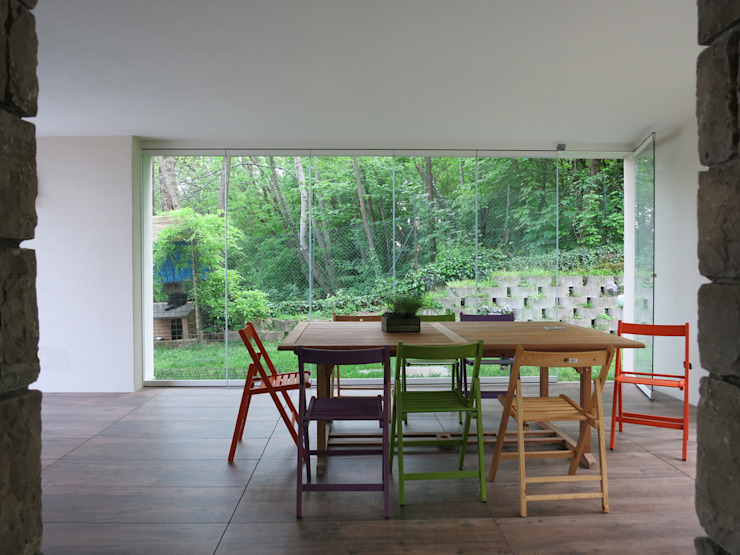 Modern conservatory by MOLTENI / BARON ASSOCIATI Modern Glass