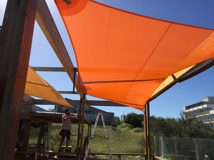 Toldos vela restaurantes de playa DIVERSA INTERIORISMO JardínPérgolas, toldos e invernaderos