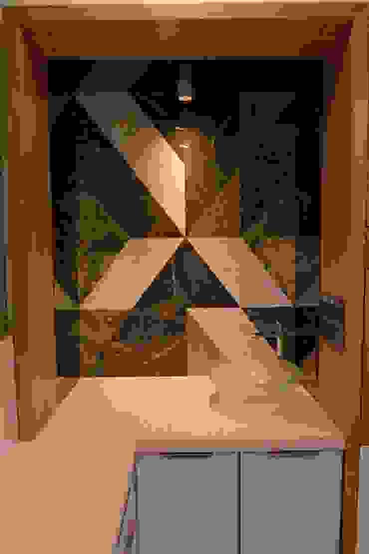 Feature Wall Minimalist hospitals by prarthit shah architects Minimalist Stone