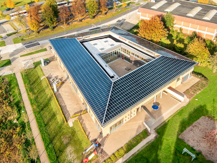 Neubau Grundschule Gronau (Leine): Plusenergieschule mit gebäudeintegrierter Photovoltaikanlage (GIPV) Architektur- und TGA-Planungsbüro Carsten Grobe Passivhaus Klassische Schulen