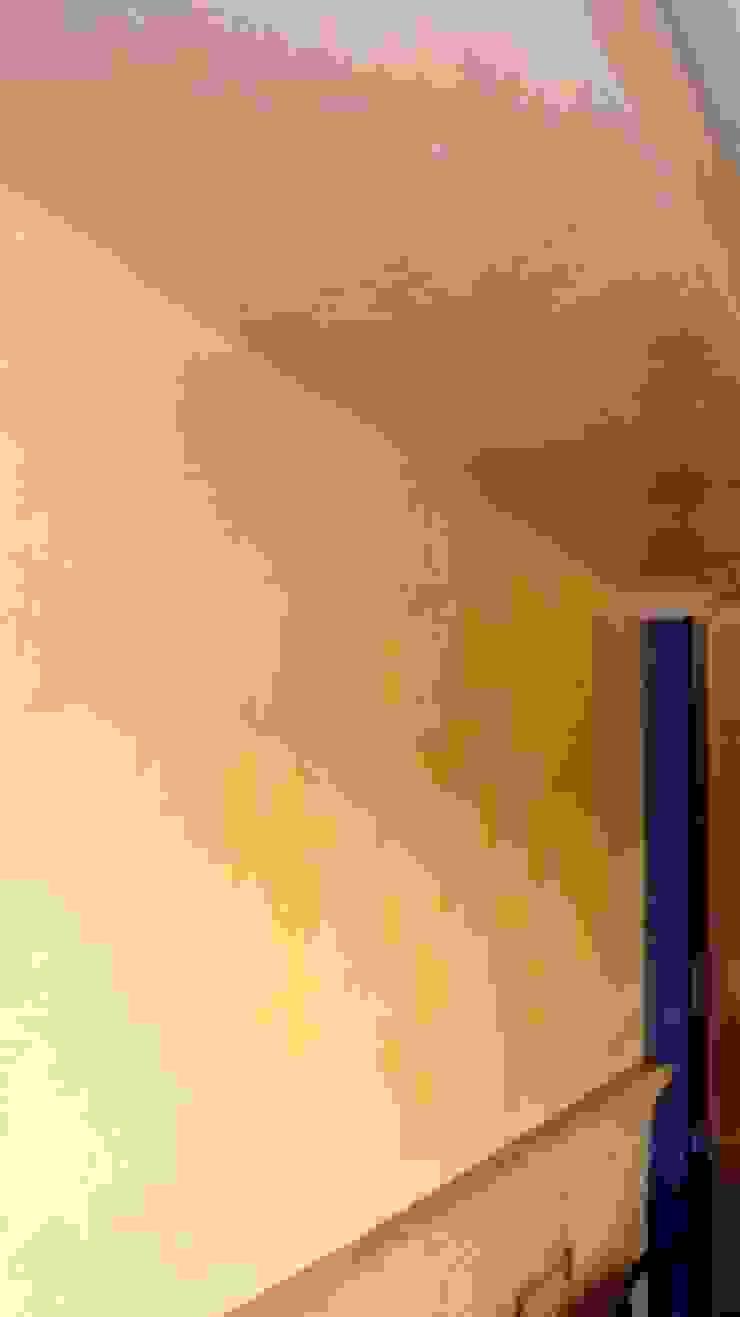 estuco con varios colores en salón Pintores Juan Jiménez Oficinas y tiendas de estilo mediterráneo