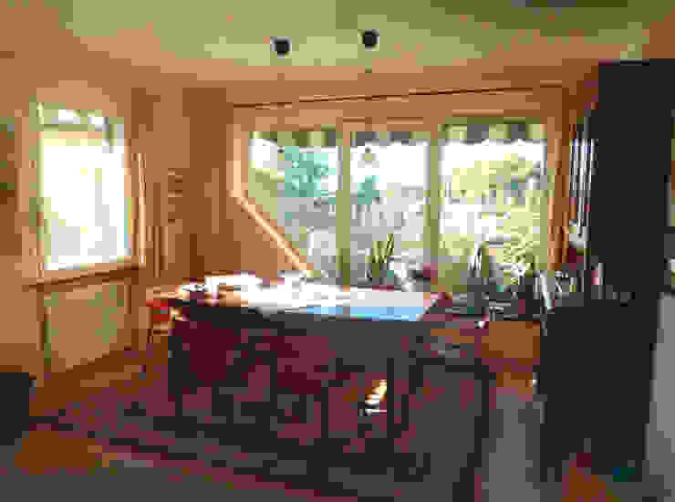Sala da pranzo con tavolo in legno rustico e sedie in cuoio di design Sala da pranzo in stile classico di Arch. Sara Pizzo - Studio 1881 Classico Pietra