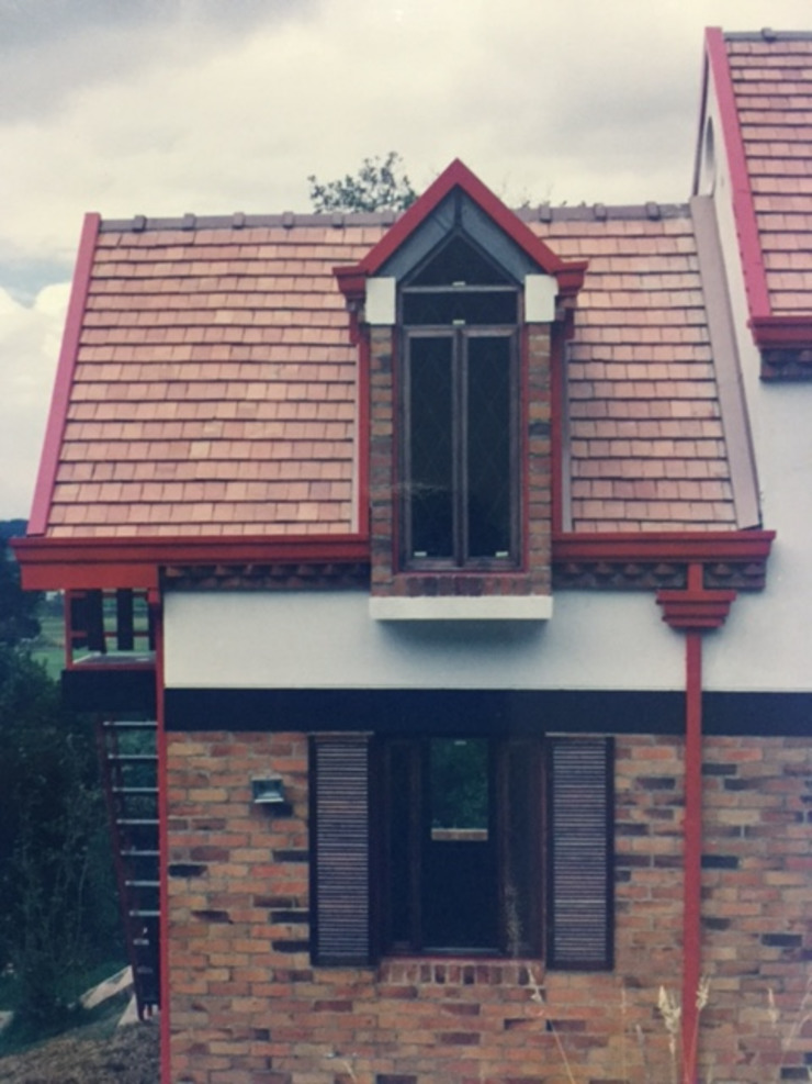 Casa Belgravia Casas de estilo rústico de V&V Arquitectos SAS Rústico