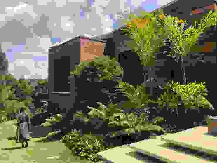 JARDÍN PRIVADO_ HABITACIONES Jardines de estilo tropical de URRETA Arquitectura del Paisaje Tropical