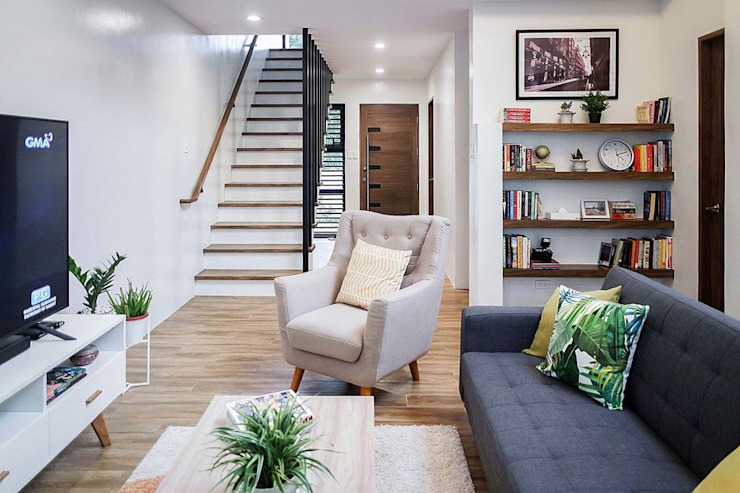 """View of main """"hall"""", wooden-threaded stairs and entrance door towards the end JAAL Builders Living room"""