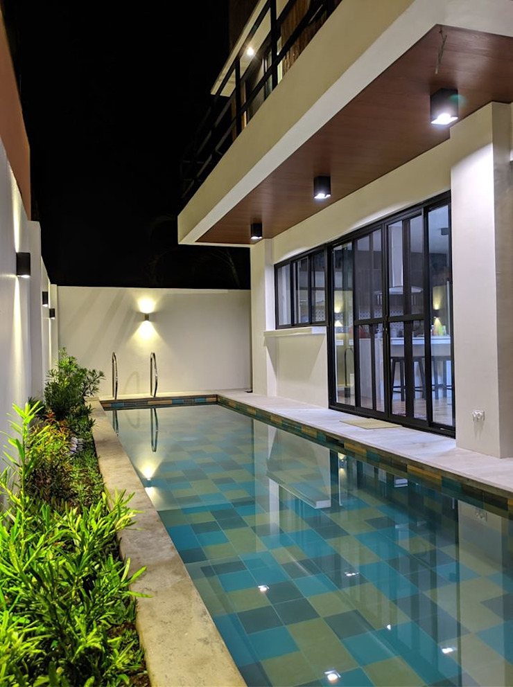 A night swim is also an inviting option by JAAL Builders Scandinavian